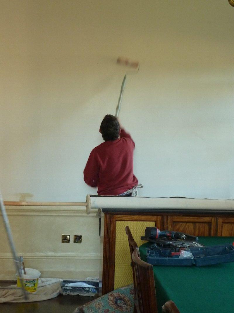 michael alford preparing a wall for a mural