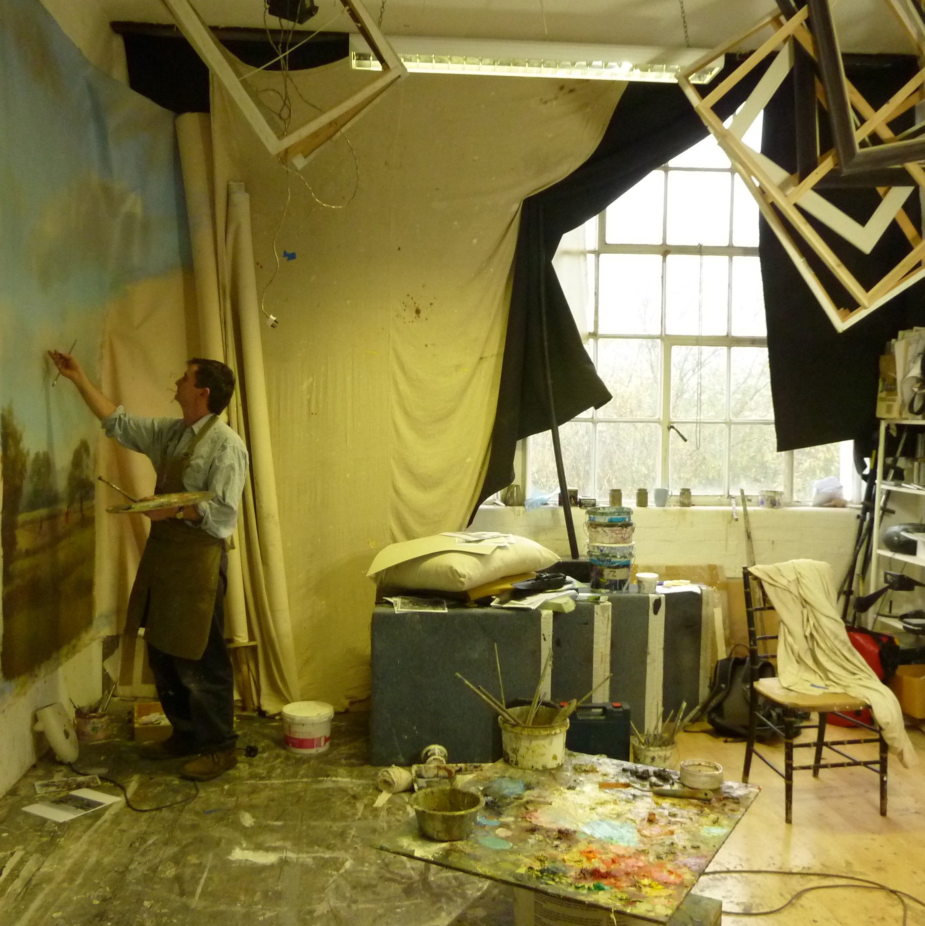 Michael Alford painting a mural in his studio