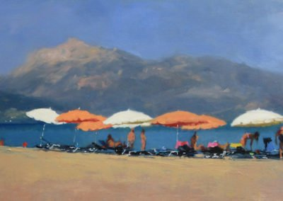 Beach umbrellas and bathers on a beach in Greece by Michael Alford